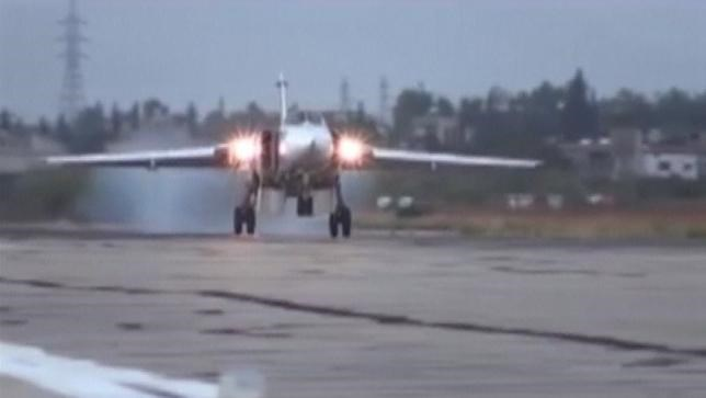 A frame grab taken from footage released by Russia's Defence Ministry October 15, 2015, shows a Sukhoi Su-24M military aircraft landing on the tarmac at the Hmeymim air base near Latakia, Syria.