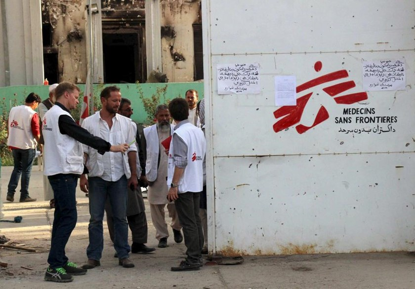 Christopher Stokes (front L), general director of Medecins Sans Frontieres (MSF), stands with other staff in front of an entrance gate of the MSF hospital in Kunduz, Afghanistan October 15, 2015.