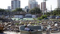 A boy plays on a disused sofa in the ruins of houses which were pulled down, in central Beijing, China, September 25, 2015.