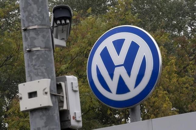 A Volkswagen logo stands next to a CCTV security camera in Wolfsburg, Germany October 7, 2015.