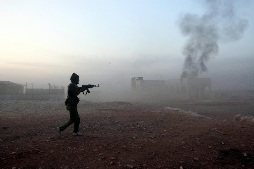 A Syrian opposition fighter fires a weapon in the Mount Azzan area, 24kms from the northern city of Aleppo, on October 17, 2015
