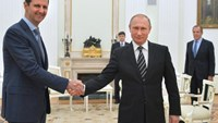 Russian President Vladimir Putin (right) shakes hands with his Syrian counterpart Bashar al-Assad during a meeting at the Kremlin in Moscow, on October 21, 2015