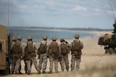 NATO soldiers attend a NATO military exercise at Raposa beach, near Setubal.