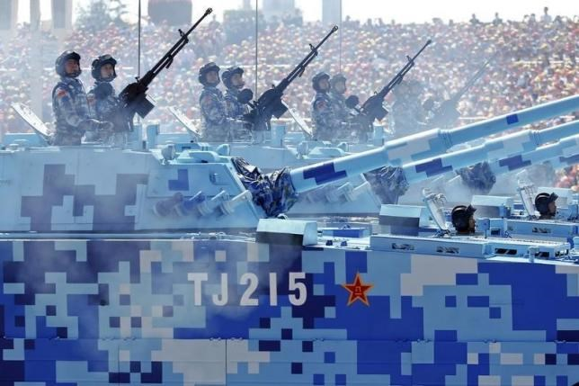 China's People's Liberation Army (PLA) navy soldiers roll on their armoured vehicles to Tiananmen Square during the military parade marking the 70th anniversary of the end of World War Two, in Beijing, China, September 3, 2015