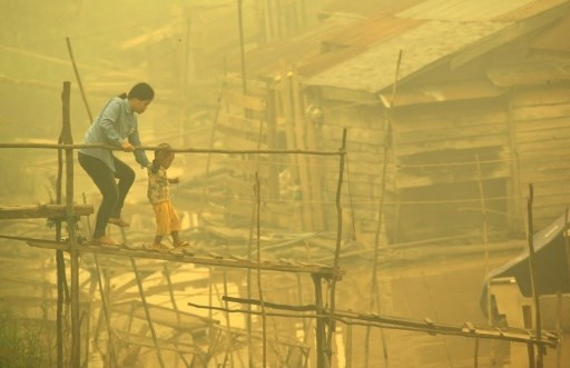 Thick haze, believed to be from Indonesia's forest fires, engulfs the city of Davao, on the southern Philippine island of Mindanao