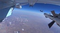 A frame grab taken from footage from a camera under a plane, released by Russia's Defence Ministry October 22, 2015, shows military jets of the Russian air force during a sortie at an unknown location in Syria.