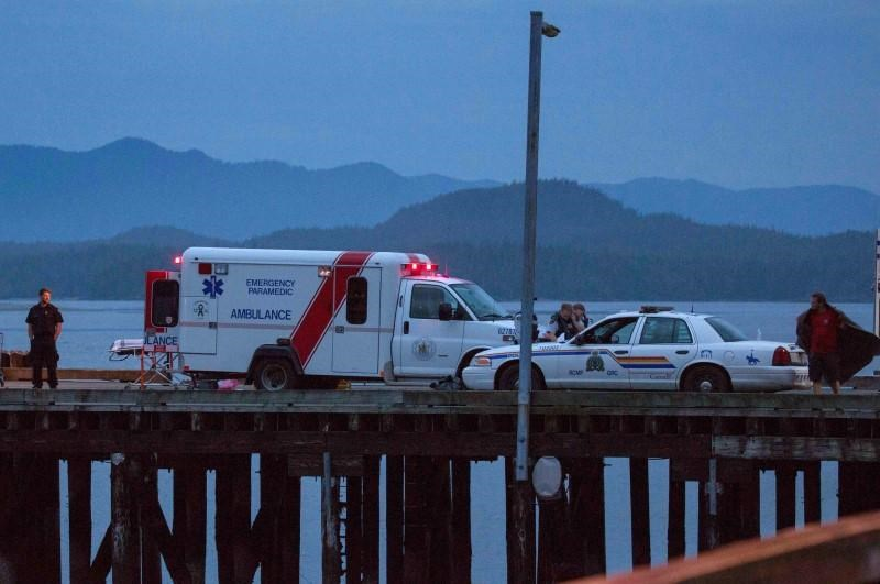 Rescue personnel mounting a search for victims of a capsized whale watching boat park on a wharf in Tofino, British Columbia October 25, 2015