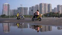 New apartment blocks stand near the Luoyang Longmen High Speed Railway Station in Henan province