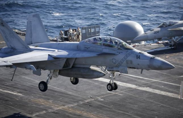 A U.S. Navy F/A-18 Super Hornet fighter lands onto the deck of the USS Ronald Reagan, a Nimitz-class nuclear-powered super carrier, in the West Sea, South Korea, October 29, 2015.