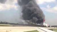 A still image from a handout video footage by Mike Dupuy, a passenger in another airplane, shows Dynamic International Airways' Boeing 767's engine on fire in Fort Lauderdale, Florida, October 29, 2015.