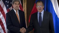 U.S. Secretary of State John Kerry (L) and Russian Foreign Minister Sergey Lavrov shake hands during a photo a photo opportunity in Vienna, October 23, 2015