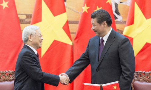 Nguyen Phu Trong, General Secretary of Vietnam's Communist Party, shakes hand with Chinese President Xi Jinping during their meeting in Beijing in April 2015