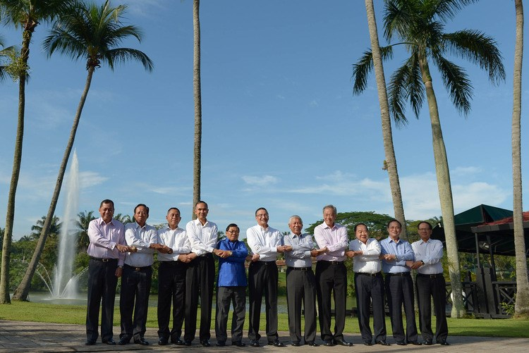 Defence chiefs from Southeast Asian nations pose for pictures ahead of their meeting. Photo: AFP