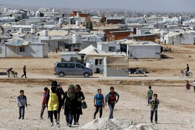Syrian refugees walk at Al Zaatari refugee camp in the Jordanian city of Mafraq, near the border with Syria, November 1, 2015.