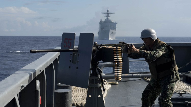 A Philippine Navy personnel mans a .50 caliber machine gun during the bilateral maritime exercise between the Philippine Navy and US Navy dubbed as Cooperation Afloat Readiness and Training (CARAT 2014) in the South China Sea near waters claimed by Beijing. Photo: AFP