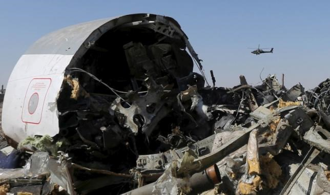 An Egyptian military helicopter flies over debris from a Russian airliner which crashed at the Hassana area in Arish city, north Egypt, in this file photograph dated November 1, 2015.