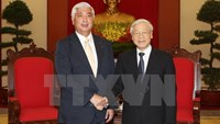 Nguyen Phu Trong (R), General Secretary of the Communist Party of Vietnam, greets Japan's Defense Minister Gen Nakatani