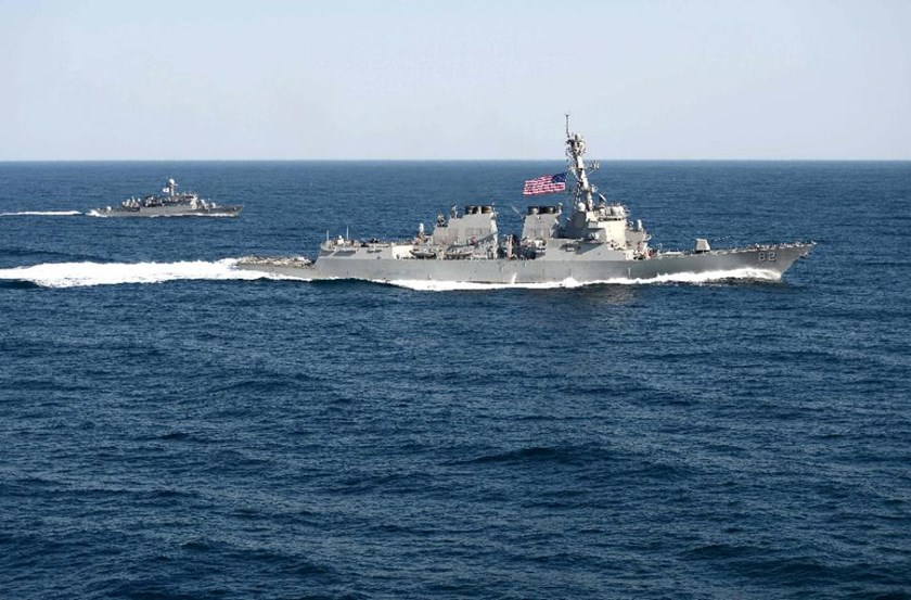 "The guided-missile detroyer USS Lassen (R) was sent by Washington to the South China Sea for a ""sail-by"" of Chinese-built islands that have raised concerns over Beijing's deepening toe-hold in the strategic waterway"