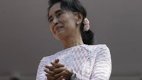 Myanmar's National League for Democracy party leader Aung San Suu Kyi looks at supporters after speaking about the general elections in Yangon, Myanmar November 9, 2015.