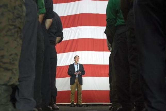 U.S. Secretary of Defense Ash Carter speaks with U.S. service members aboard the USS Theodore Roosevelt aircraft carrier in the South China Sea, in this handout photograph taken and released on November 5, 2015.