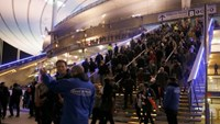 Crowds leave the Stade de France where explosions were reported to have detonated outside the stadium during the France vs German friendly match near Paris, November 13, 2015.
