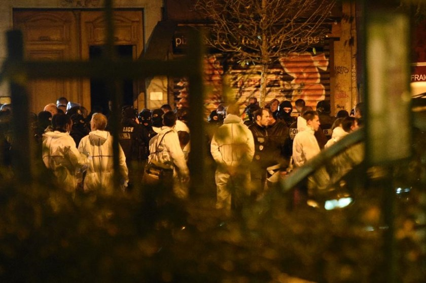 Police forces and forensic experts gather near the Bataclan concert hall in central Paris, on November 14, 2015