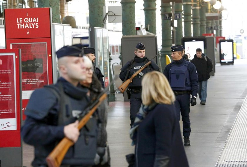 Police patrol the Gare du Nord train station the morning after a series of deadly attacks in Paris , November 14, 2015.