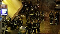 Police and rescuers are seen outside a cafe-brasserie in 10th arrondissement of the French capital Paris, on November 13, 2015