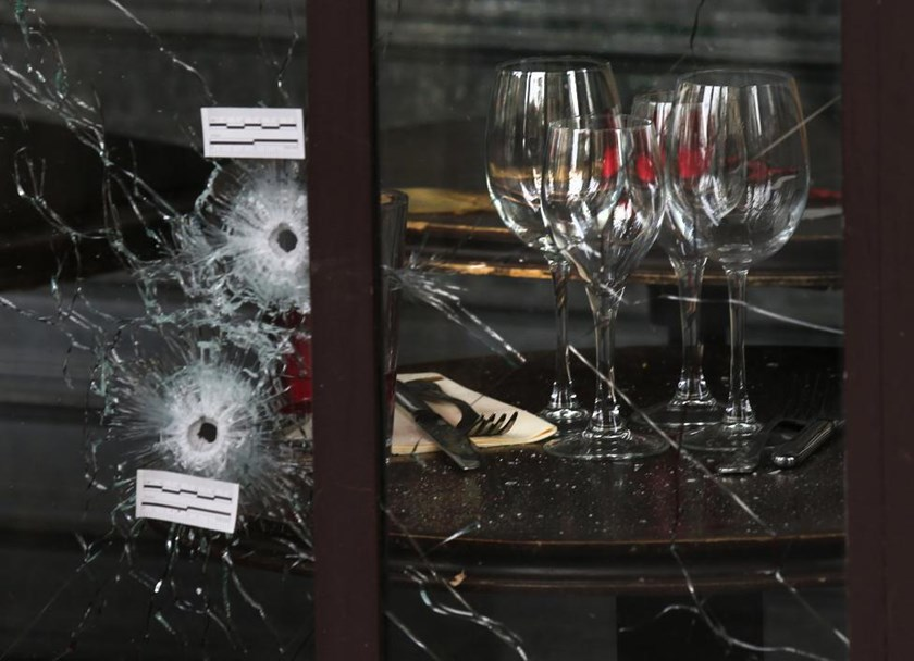Bullet impacts are seen in the window of a restaurant window the day after a series of deadly attacks in Paris , November 14, 2015.