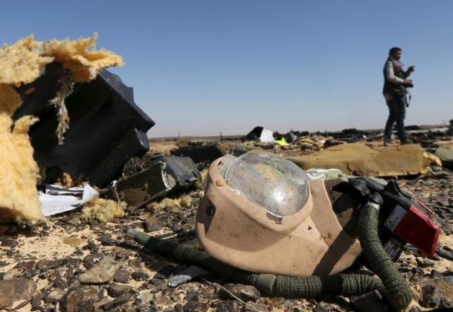 A debris from a Russian airliner is seen at its crash site at the Hassana area