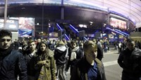 Football fans leave the Stade de France stadium following the friendly football match between France and Germany in Saint-Denis, north of Paris, on November 13, 2015