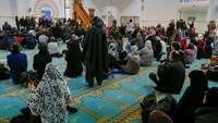 Several hundred people, Muslims and non-Muslims, gather to pray at the Grande Mosque in Lyon, France, November 15, 2015, for the victims of the series of shootings in Paris on Friday.