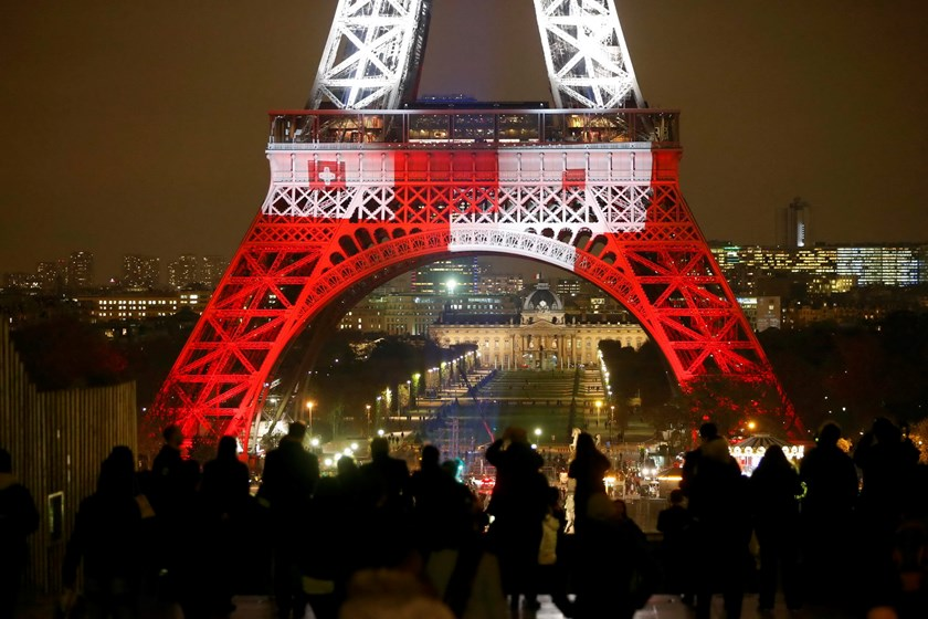 The Eiffel Tower is lit in the colours of the French flag in Paris, France, November 16, 2015, to pay tribute to the victims of a series of deadly attacks on Friday in the French capital. Photo: Reuters/Charles Platiau