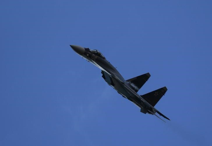 "A Sukhoi SU-35 fighter aircraft performs during the ""Aviadarts"" military aviation competition at the Dubrovichi range near Ryazan"