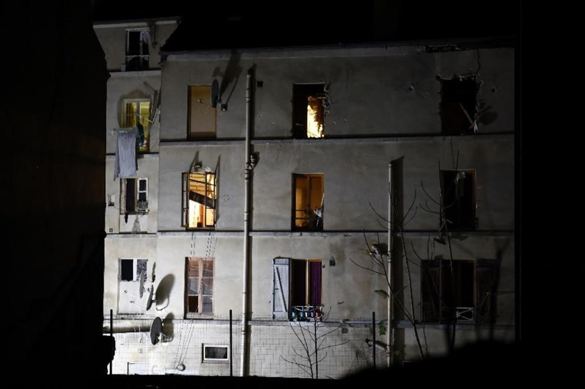 The building in the northern Paris suburb of Saint-Denis, is seen on November 18, 2015, where French Police special forces raided an apartment, hunting those behind the attacks that claimed 129 lives in the French capital