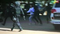 Still image from video show a hostage rushed out from the Radisson hotel in Bamako, Mali, November 20, 2015.