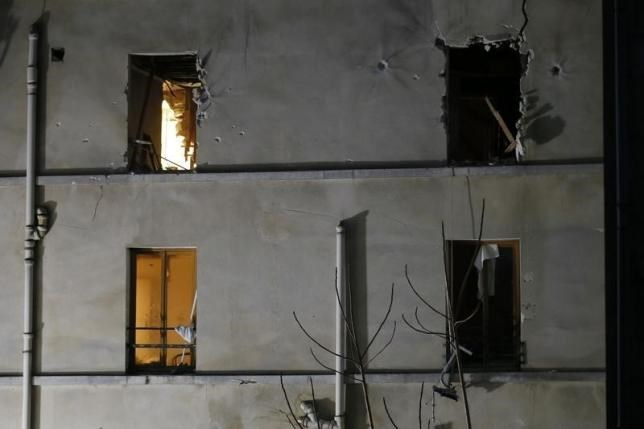 A view shows impacts around windows on the facade of the apartment raided by French Police special forces earlier in Saint-Denis, near Paris, France, November 18, 2015 during an operation to catch fugitives from Friday night's deadly attacks in the French capital.