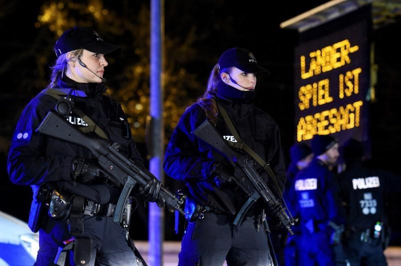 File photo of armed police standing outside the stadium in front of a board announcing the cancellation of the Germany Netherlands internationl friendly soccer match due to a security threat, in Hanover, Germany November 17, 2015.