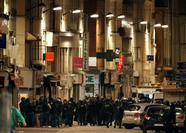 French special police forces secure the area as shots are exchanged in Saint-Denis, France, near Paris, November 18, 2015 during an operation to catch fugitives from Friday night's deadly attacks in the French capital.