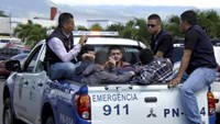 Policemen escort five Syrian men after they were detained at Toncontin international airport in Tegucigalpa, Honduras, November 18, 2015.