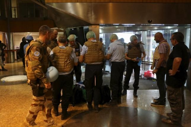 French gendarmes prepare forensic supplies in the lobby of the Radisson hotel in Bamako, Mali, November 20, 2015.