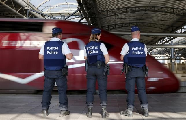 Belgian police officers stand guard on a platform at the Thalys high-speed train terminal at Brussels Midi/Zuid railway station.