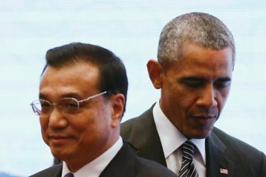 U.S. President Barack Obama walks behind China's Premier Li Keqiang as they attend a family photo at the 27th Association of Southeast Asian Nations Summit.