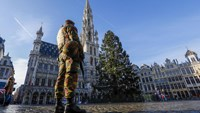 A Belgian soldier patrols in Brussels' Grand Place as police searched the area during a continued high level of security following the recent deadly Paris attacks, Belgium, November 23, 2015.