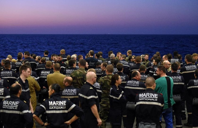 French navy personnel muster aboard the aircraft carrier Charles de Gaulle, deployed in the eastern Mediterraean, on November 23, 2015