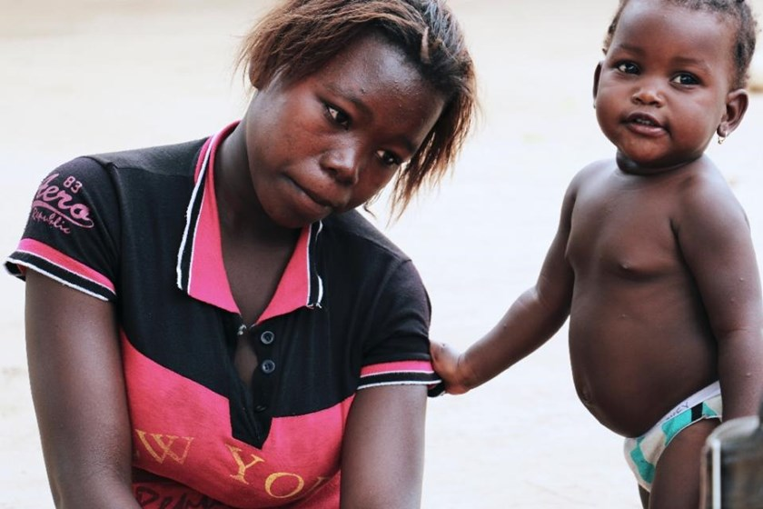Albertina Ricardo, 17, sits next to her child in Inhambane, Mozambique