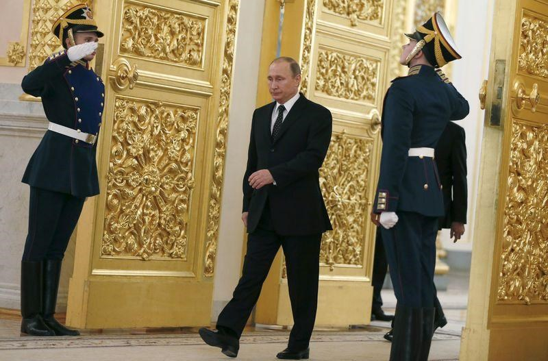 Russia's President Vladimir Putin walks past honor guards as he attends a ceremony to receive diplomatic credentials from foreign ambassadors at the Kremlin in Moscow, Russia, November 26, 2015.