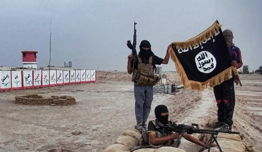 An image made available on the jihadist website Welayat Salahuddin on June 11, 2014 allegedly shows Islamic State group militants posing with the trademark Jihadists flag after they seized an Iraqi army checkpoint in Salahuddin province