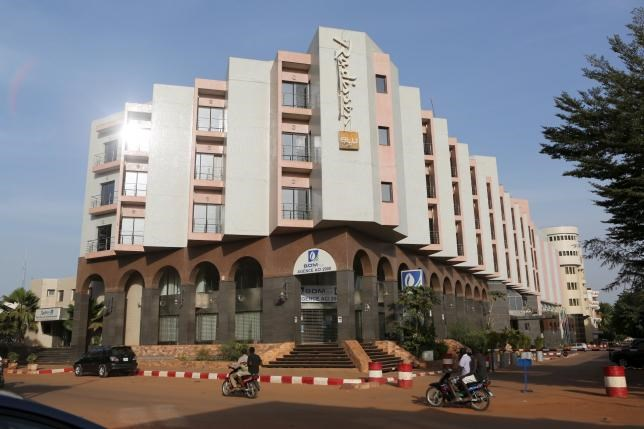 People drive motorcycles past the Radisson Blu hotel in Bamako, Mali, November 22, 2015.