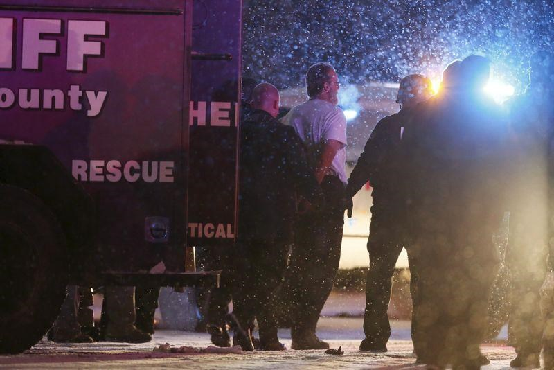 A suspect is taken into custody outside a Planned Parenthood center in Colorado Springs, November 27, 2015.